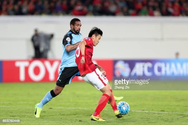Zou Zheng of Guangzhou Evergrande in action against Eduardo Neto of Kawasaki Frontale during 2017 AFC Asian Champions League group match between...