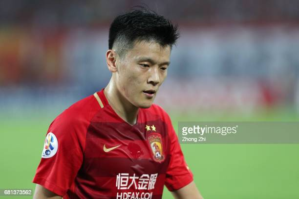 Zou Zheng of Guangzhou Evergrande looks on during the AFC Champions League Group G match between Guangzhou Evergrande and Suwon Samsung Bluewings at...
