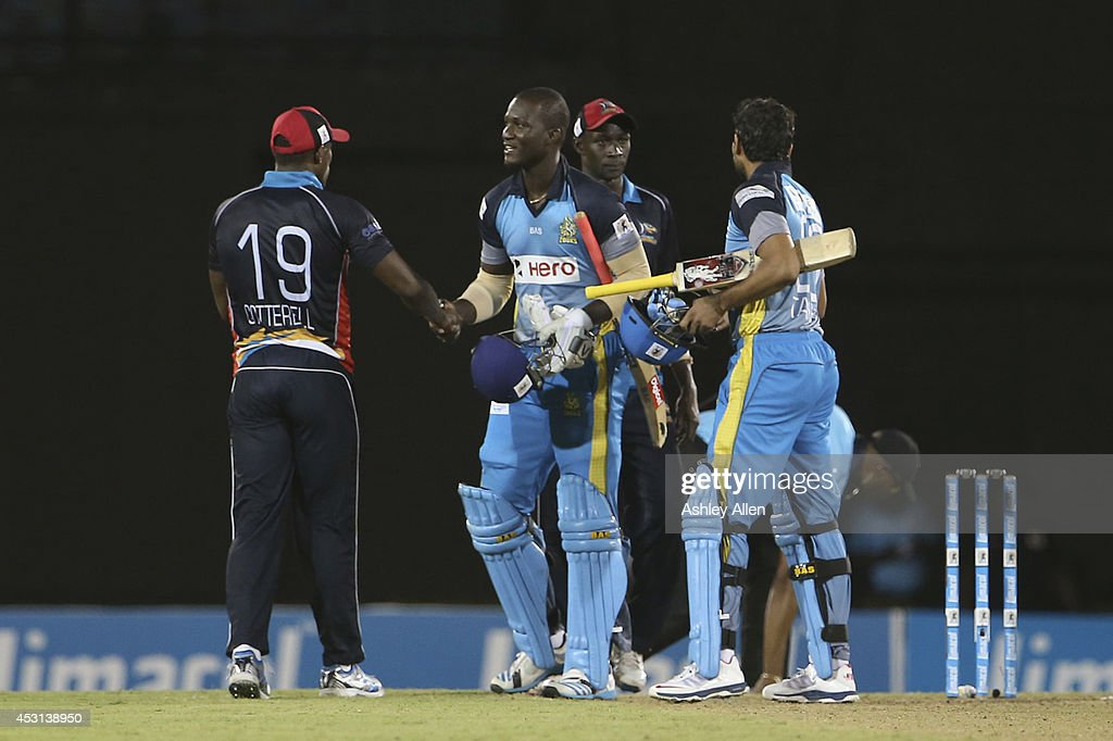 Zouks captain <a gi-track='captionPersonalityLinkClicked' href=/galleries/search?phrase=Darren+Sammy&family=editorial&specificpeople=2920912 ng-click='$event.stopPropagation()'>Darren Sammy</a> shakes hands with Sheldon Cotterell as the St Lucia Zouks defeat the Antigua Hawksbills. Part of week 4 of the Limacol Caribbean Premier League 2014 at Beausejour Stadium on August 03, 2014 in Castries, St. Lucia.