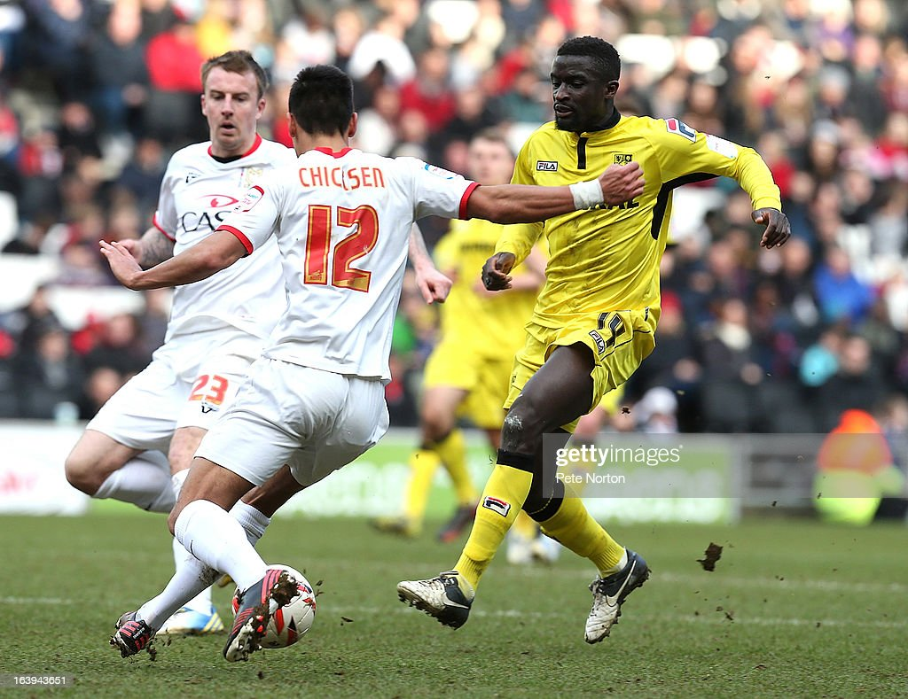 Zoumana Bakayogo of Tranmere Rovers contests the ball with Adam Chicksen of MK Dons during the npower League One match between MK Dons and Tranmere Rovers at Stadium MK on March 16, 2013 in Milton Keynes, England.