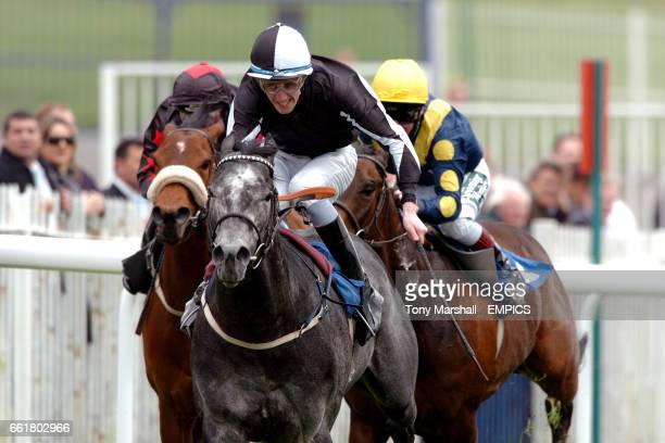 Zowington ridden by G Baker leads the World Cup Cashback At Blue Square Handicap