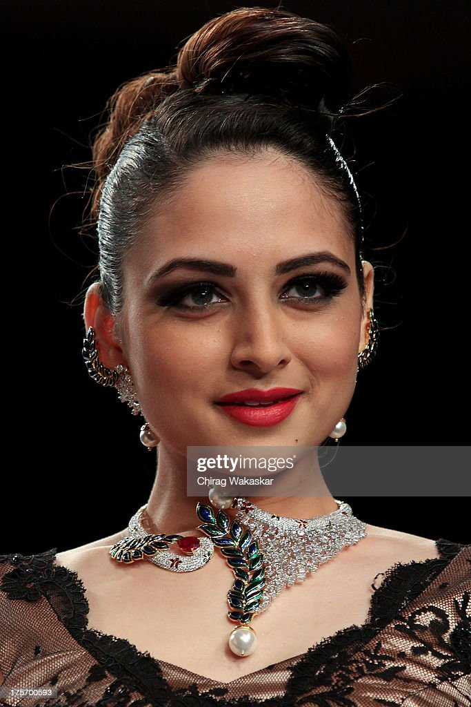 Zoya Afroz walks the runway at the International Gemological Institute show on day 3 of India International Jewellery Week 2013 at the Hotel Grand Hyatt on August 6, 2013 in Mumbai, India.
