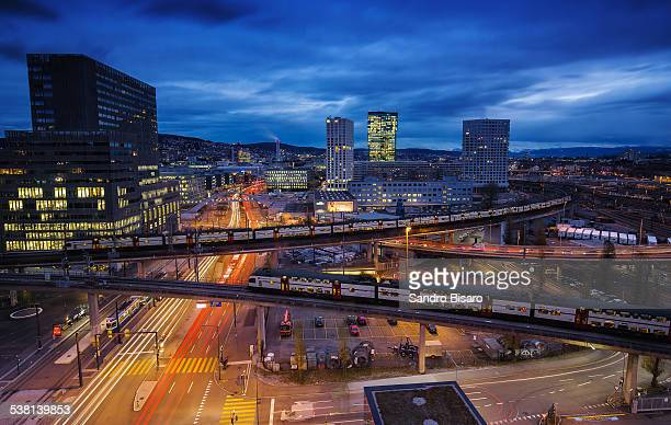 Z?rich Cityscape at night with trains passing