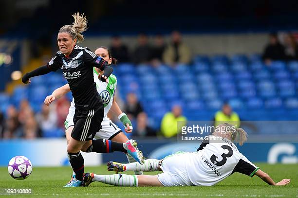 Zsanett Jakabfi of VfL Wolfsburg tackles Camille Abily of Olympique Lyonnais during the UEFA Women's Champions League Final Match between VfL...