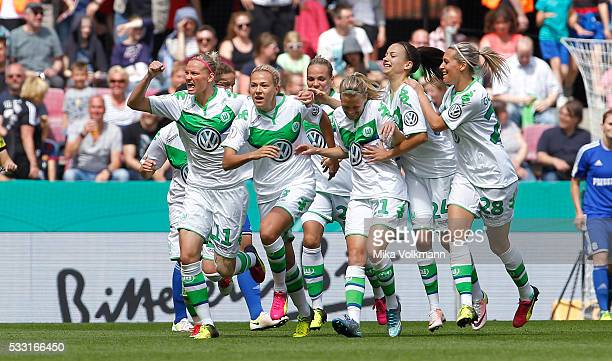 Zsanett Jakabfi of Wolfsburg celebrates scoring the 10 goal with Alexandra Popp of Wolfsburg and teammates during the women's cup final between SC...