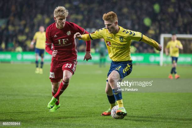 Zsolt Kalmar of Brondby IF and Alexander Munksgaard of Lyngby BK the Danish Alka Superliga match between Brondby IF and Lyngby BK at Brondby Stadion...