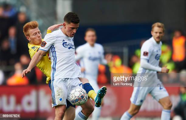 Zsolt Kalmar of Brondby IF and Benjamin Verbic of FC Copenhagen compete for the ball during the Danish Alka Superliga match between Brondby IF and FC...