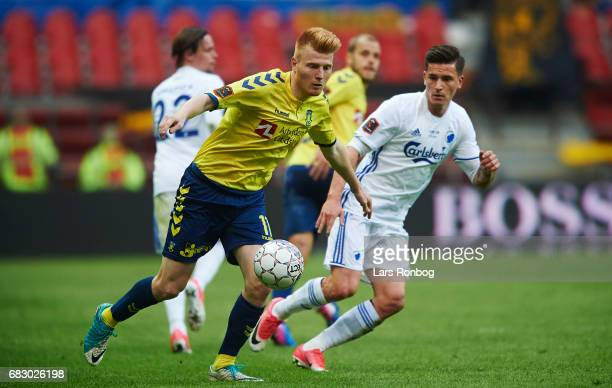 Zsolt Kalmar of Brondby IF and Benjamin Verbic of FC Copenhagen compete for the ball during the Danish Alka Superliga match between FC Copenhagen and...