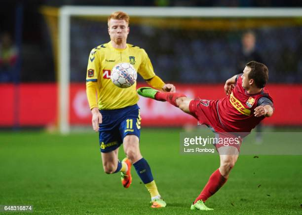 Zsolt Kalmar of Brondby IF and Stanislav Lobotka of FC Nordsjalland compete for the ball during the Danish Alka Superliga match between Brondby IF...