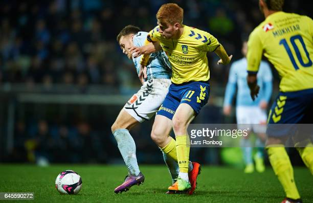 Zsolt Kalmar of Brondby IF and Troels Klove of Sonderjyske compete for the ball during the Danish Alka Superliga match match between Sonderjyske and...