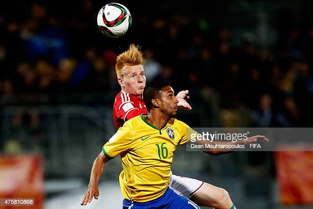 Zsolt Kalmar of Hungary and Jorge of Brazil battle for the ball during the FIFA U20 World Cup New Zealand 2015 Group E match between Hungary and...