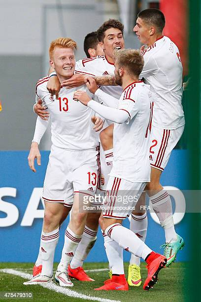 Zsolt Kalmar of Hungary celebrates scoring his teams second goal with team mates during the FIFA U20 World Cup New Zealand 2015 Group E match between...