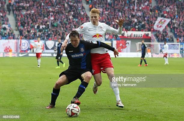 Zsolt Kalmar of Leipzig and Alexander Bittroff of Frankfurt vie during the Second Bundesliga match between RB Leipzig and FSV Frankfurt at Red Bull...