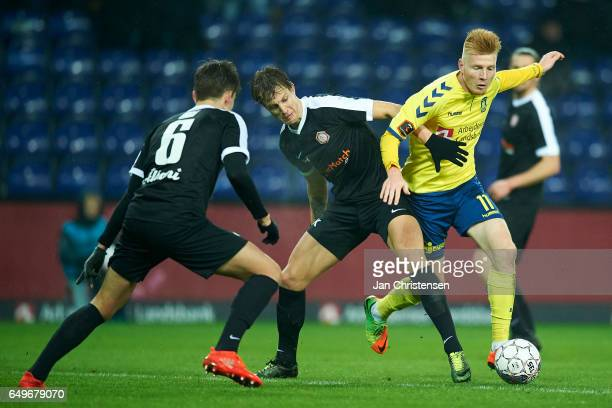 Zsolt Kalmár of Brondby IF compete for the ball during the Danish Cup DBU Pokalen match between BK Marienlyst and Brondby IF at Brondby Stadion on...