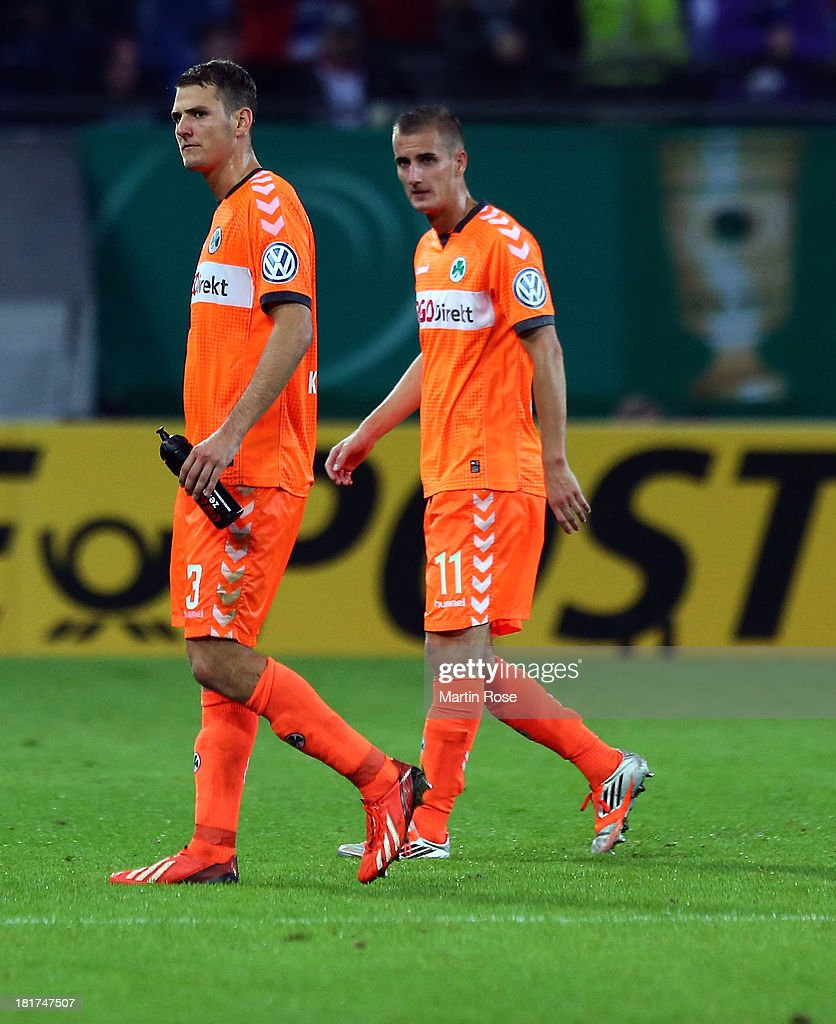 Zsolt Korcsmar (L) and Dominick Drexler (R) of Greuther Fuerth walk off dejected after the DFB Cup second round match between Hamburger SV and Greuther Fuerth at Imtech Arena on September 24, 2013 in Hamburg, Germany.