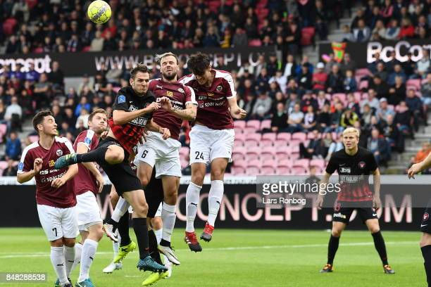 Zsolt Korcsmar of FC Midtjylland Nicholas Gotfredsen of Hobro IK and Rasmus Minor Petersen of Hobro IK compete for the ball during the Danish Alka...