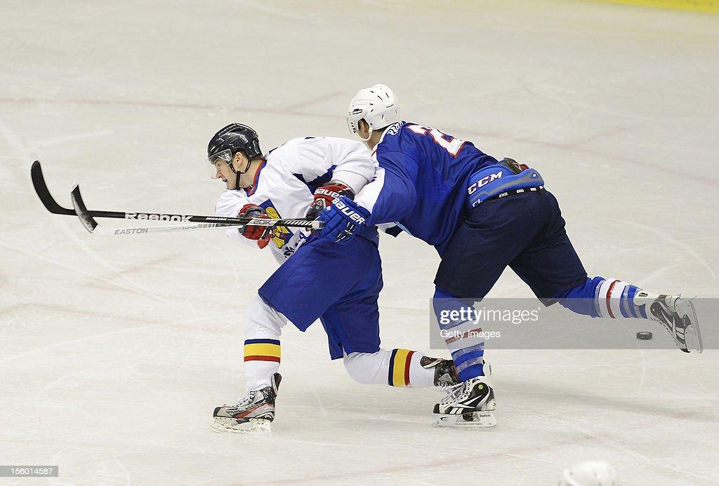 Zsolt Molnar #7 of Romania skates against Park Woosang #26 of South Korea during the Ice Hockey Sochi Olympic Pre-Qualification Group J match between South Korea and Romania at Nikko Kirifuri Ice Arena on November 11, 2012 in Nikko, Tochigi, Japan. South Korea won 2-0.
