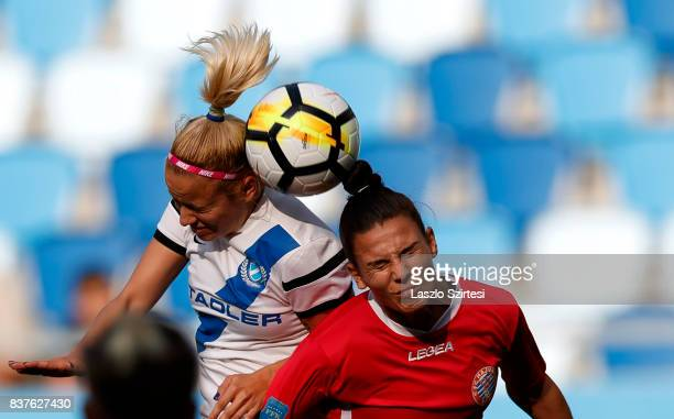 Zsuzsanna Szabo of MTK Hungaria FC competes for the ball in the air with Endrina Elezaj of WFC Hajvalia during the UEFA Women's Champions League...
