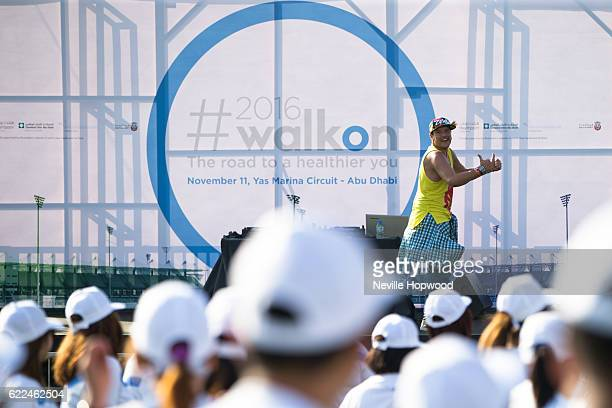 A zubma instructor takes a zumba fitness class at the Yas Marina Circuit prior to the 10th annual Abu Dhabi Walk from Imperial College London...