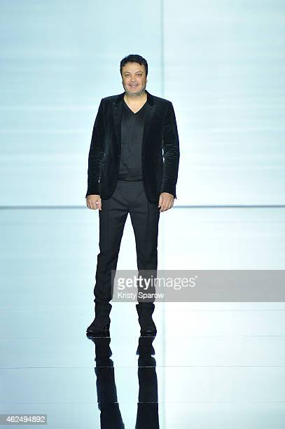 Zuhair Murad acknowledges the audience during the Zuhair Murad show as part of Paris Fashion Week Haute Couture Spring/Summer 2015 at Palais de Tokyo...
