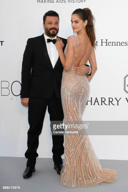 Zuhair Murad and Izabel Goulart arrives at the amfAR Gala Cannes 2017 at Hotel du CapEdenRoc on May 25 2017 in Cap d'Antibes France