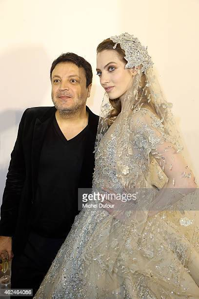 Zuhair Murad and model pose backstage after the Zuhair Murad show as part of Paris Fashion Week HauteCouture Spring/Summer 2015 on January 29 2015 in...