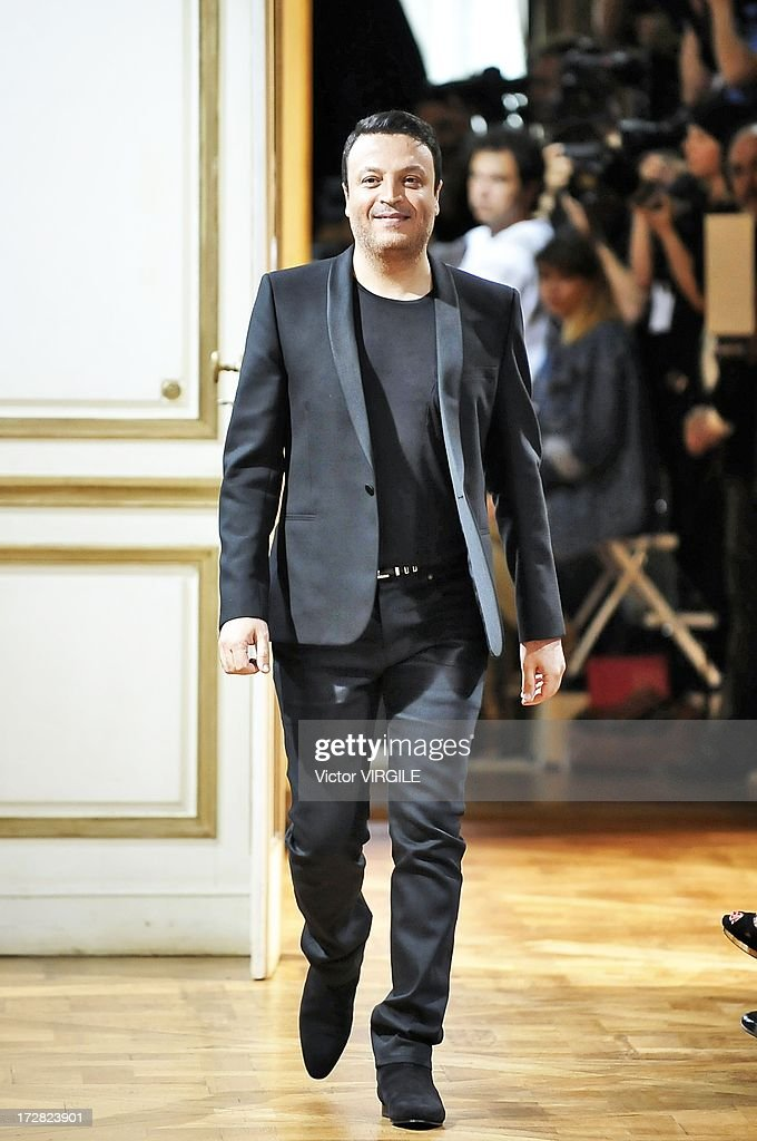 Zuhair Murad walks the runway during the Zuhair Murad show as part of Paris Fashion Week Haute-Couture Fall/Winter 2013-2014 at the Hotel de Montmorency on July 4, 2013 in Paris, France.