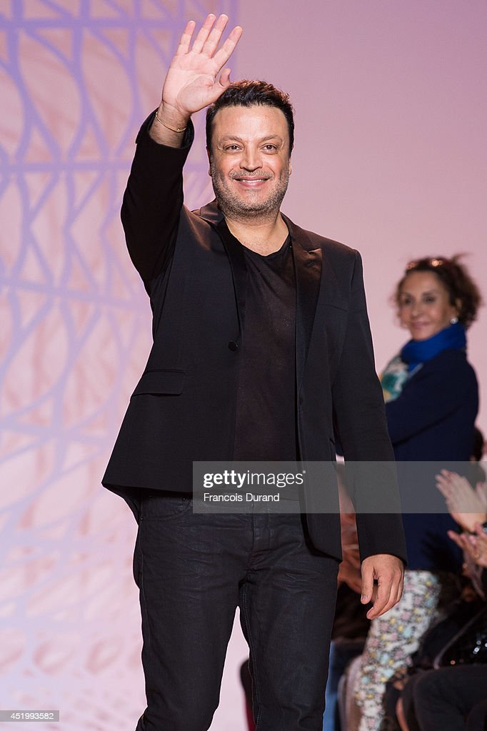 Zuhair Murad walks the runway during the Zuhair Murad show as part of Paris Fashion Week - Haute Couture Fall/Winter 2014-2015 at Palais Des Beaux Arts on July 10, 2014 in Paris, France.