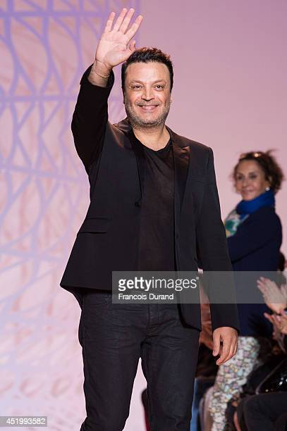 Zuhair Murad walks the runway during the Zuhair Murad show as part of Paris Fashion Week Haute Couture Fall/Winter 20142015 at Palais Des Beaux Arts...