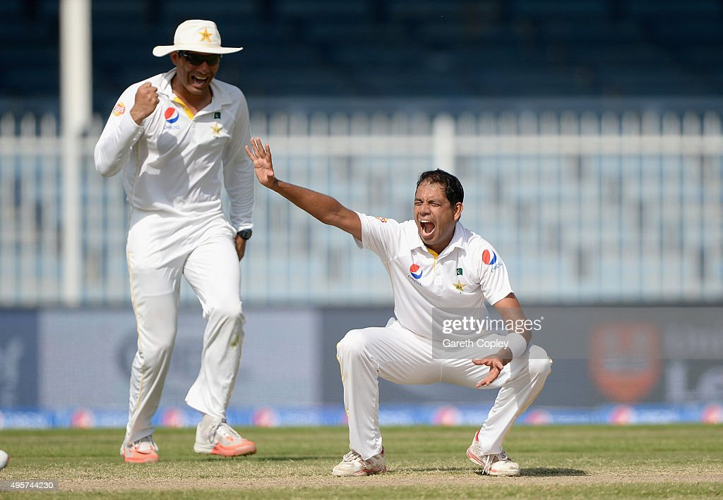 Zulfiqar Babar of Pakistan celebrates alongside captain <a gi-track='captionPersonalityLinkClicked' href=/galleries/search?phrase=Misbah-ul-Haq&family=editorial&specificpeople=2180557 ng-click='$event.stopPropagation()'>Misbah-ul-Haq</a> after dismissing Samit Patel of England during day five of the 3rd Test between Pakistan and England at Sharjah Cricket Stadium on November 5, 2015 in Sharjah, United Arab Emirates.