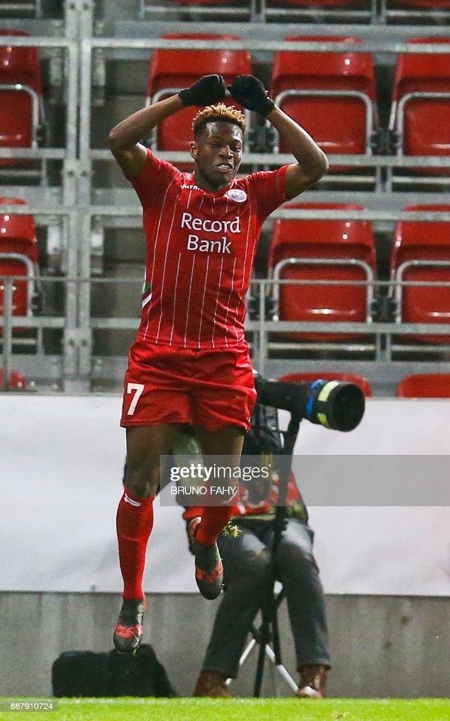 Zulte's Aaron Leya Iseka celebrates after scoring during the UEFA Europa League Group K football match between SV Zulte Waregem and Lazio at The Regenboogstadion in Waregem on December 7, 2017. / AFP PHOTO / Belga / BRUNO FAHY / Belgium OUT