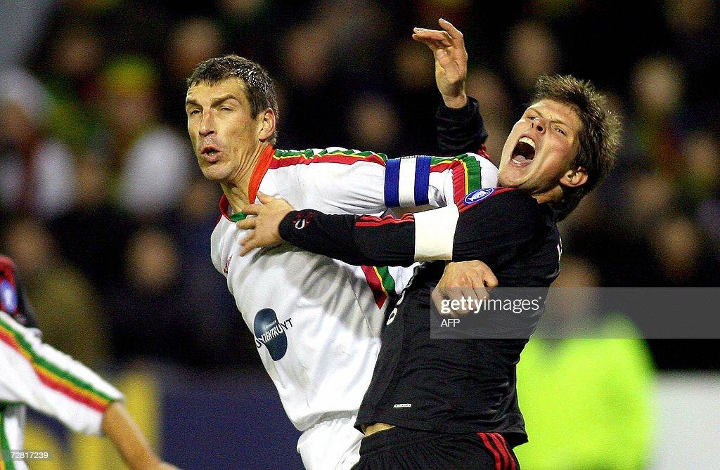 Zulte's Stefan Leleu fights for the ball with Ajax' Klaas Jan Huntelaar during their UEFA soccer Cup qualifying match ZulteWaregem vs Ajax Amsterdam...