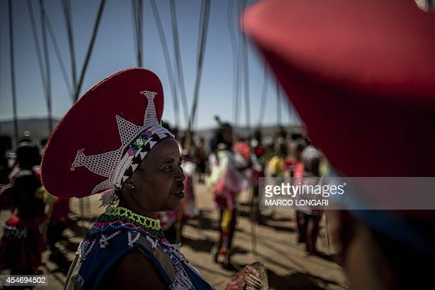 Zulu elders preside as ceremonial reeds are carried by South African maidens during the Reed Dance ceremony on September 5 2014 at the eNyokeni Royal...