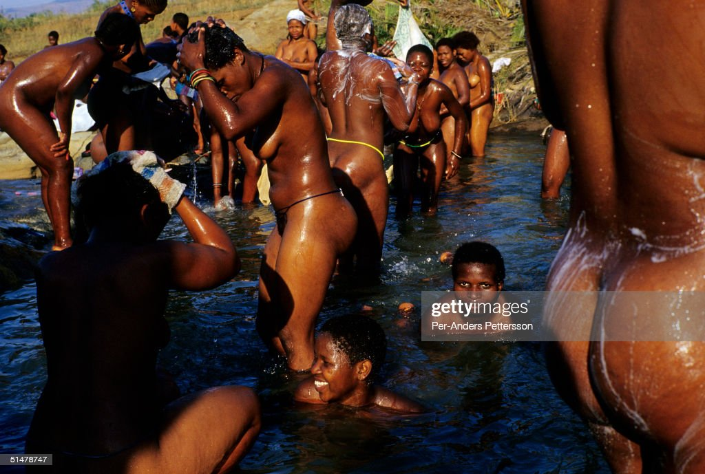 Zulu maidens take a traditional bath in a river during the annual Reed Dance on September 11, 2004 in Nongoma in rural Natal, South Africa. About 20,000 maidens from all over South Africa has arrived to dance for Zulu King Goodwill Zwelethini at the Enyokeni Royal Palace in Kwa-Nongoma about 350 kilometers from Durban. The girls come to the kingdom to declare their virginity and the ceremony encourages girls and young women to abstain from sexual activity to curb the spread of HIV