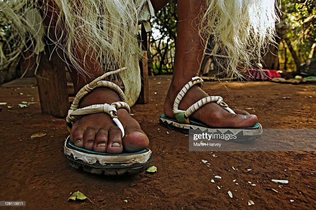 Zulu man in traditional dress with sandals made from car tires. Lesedi Cultural Village near Johannesburg, South Africa