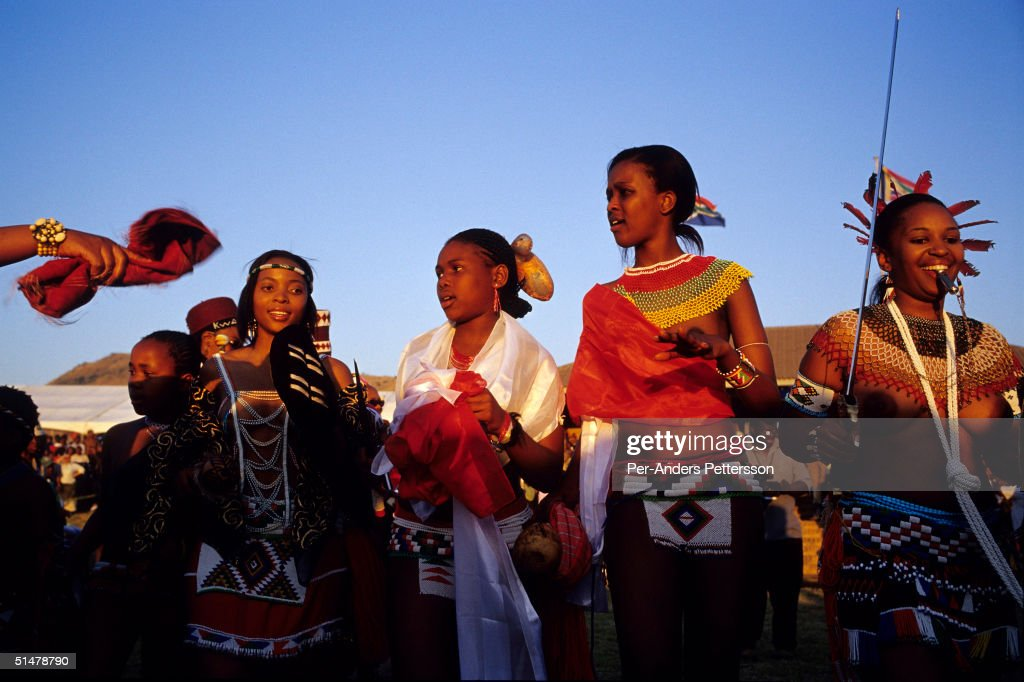 Zulu princesses dance at the Royal Palace during the annual Reed Dance on September 11, 2004 in Nongoma in rural Natal, South Africa. About 20,000 maidens from all over South Africa arrived to dance for Zulu King Goodwill Zwelethini at the Enyokeni Royal Palace in Kwa-Nongoma about 350 kilometers from Durban. The girls come to the kingdom to declare their virginity and the ceremony encourages girls and young women to abstain from sexual activity to curb the spread of HIV/AIDS.