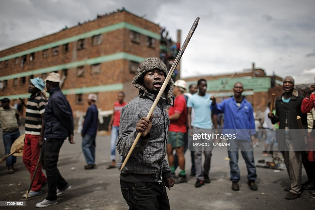 Zulu protesters demonstrate against foreign migrants outside their hostel in the Jeppestown district of Johannesburg on April 17 2015 AFP PHOTO/MARCO...