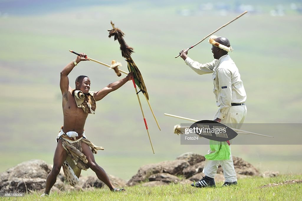 'Zulu Warriors' showing their respect following Madiba's State Funeral on December 15, 2013 in Qunu, South Africa. Nelson Mandela passed away on the evening of December 5, 2013 at his home. He is laid to rest at his homestead in Qunu during a State Funeral.