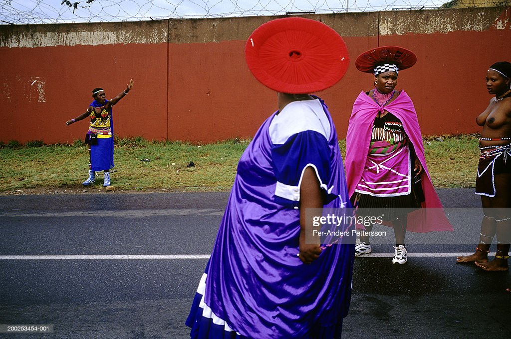 Zulu women dressed in traditional clothing stop the traffic as they are marching with about fifty virgins that celebrate their virginity on March 11, 2005 in Soweto, Johannesburg, South Africa. The girls were earlier checked if they were virgins or not. Soweto is the biggest township in South Africa, and has a population of about 3.5 million.