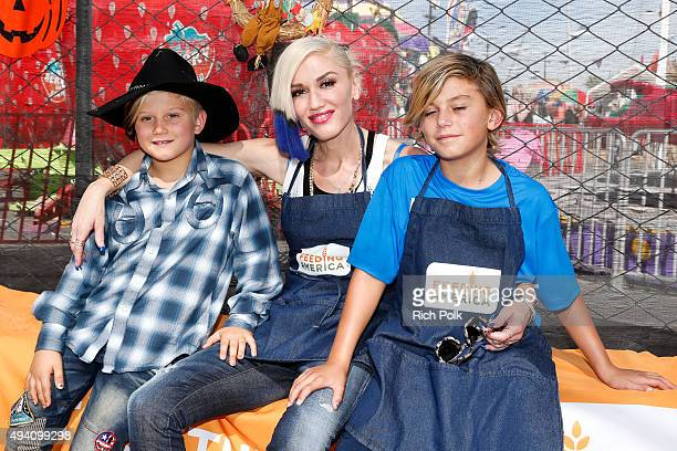 Zuma Rossdale singer Gwen Stefani and Kingston Rossdale volunteer at the Feeding America Holiday Harvest event at Shawn's Pumpkin Patch in...