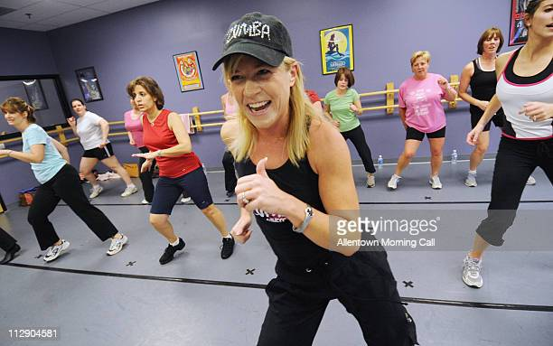 Zumba instructor Shawn Schmitt of Allentown Pennsylvania leads her class Zumba is a new group fitness trend that offers a LatinAmerican inspired...