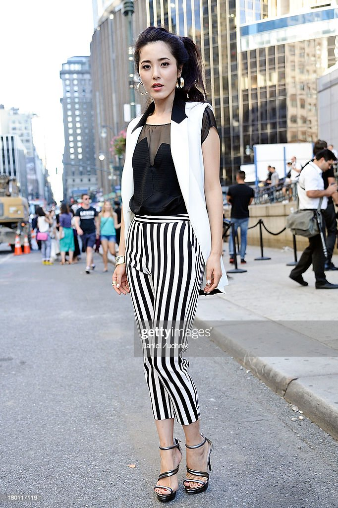 Zung Vi is seen outside the Y3 show on September 8, 2013 in New York City.