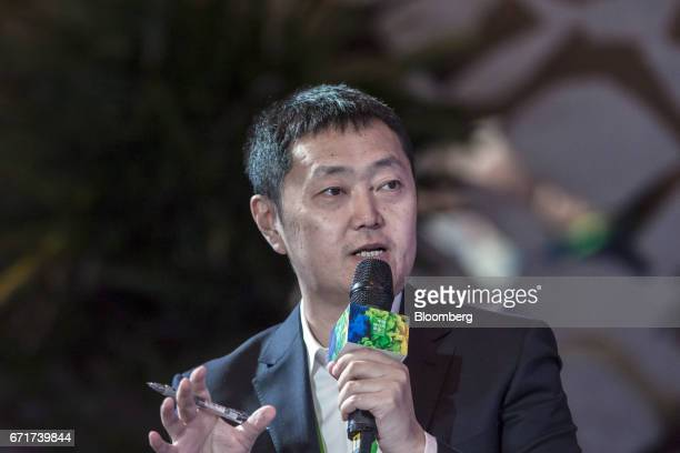 Zuo Hui president of Beijing Homelink Real Estate Brokerage Co speaks during a session at the China Green Companies Summit in Zhengzhou China on...