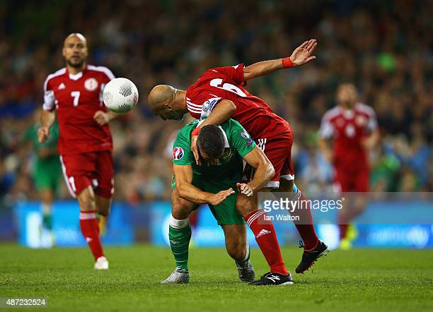 Zurab Khizanishvili of Georgia challenges Jonathan Walters of the Republic of Ireland during the UEFA EURO 2016 Group D qualifying match between...