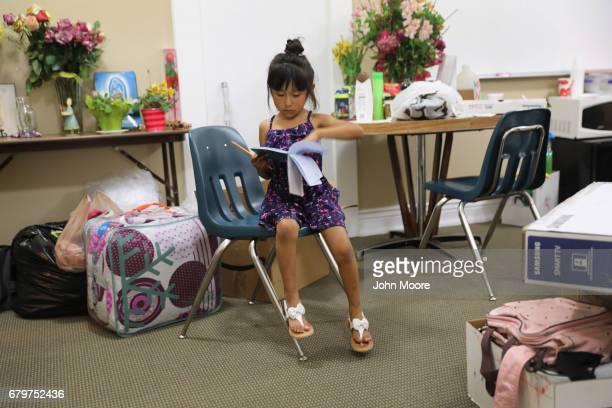 Zuri the daughter of undocumented immigrant Jeanette Vizguerra looks through a notebook while visiting her mother who is taking sanctuary at the...