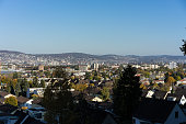 zurich outskirts panorama view with blue sky from forest
