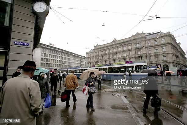 SWITZERLAND ZURICH Zurich Paradeplatz buildings of UBS and Credit Suisse in the rain
