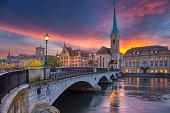 Cityscape image of Zurich, Switzerland during dramatic sunset.
