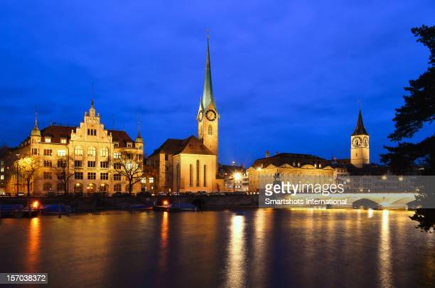 Zurich skyline at dusk with reflection on Limmat