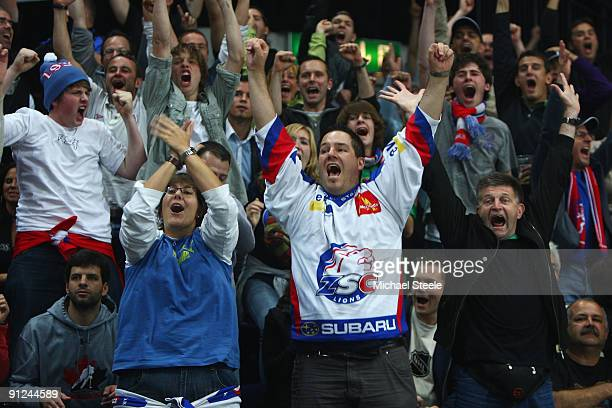 Zurich supporters celebrate their sides first goal during the ZSC Lions Zurich v Chicago Blackhawks Victoria Cup match at the Hallenstadion Arena on...